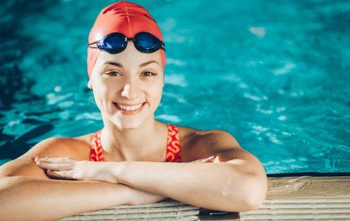 girl wearing swim cap