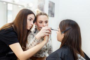 makeup teacher teaching student