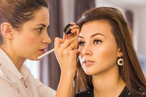 esthetician applying makeup