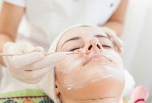 esthetician applying facial