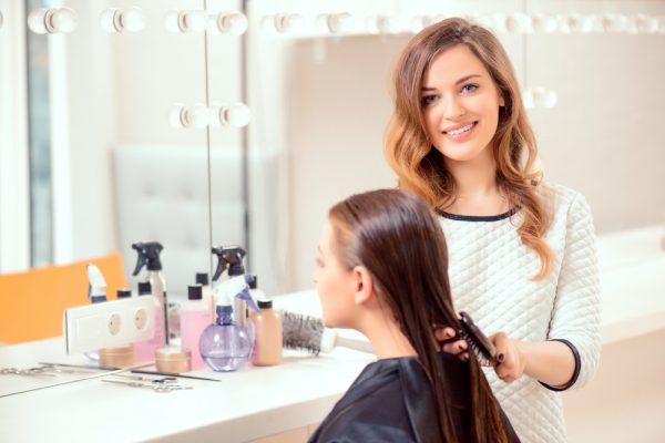 hairdresser helping woman look beautiful
